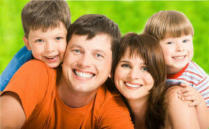 Smiling Family with White Teeth